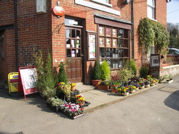 Chiddingfold Post Office with display  of flowers for sale