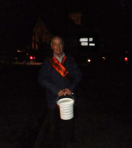 Man with charity collecting bucket