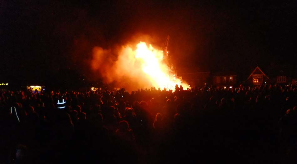 Crowd watching bonfire