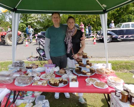 couple of people at cake stall