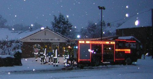 Fire engine - outside Vets  - - snowing