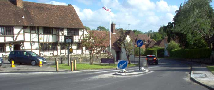 Pedestrian crossing with The Crown Inn Chiddingfold in background